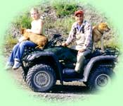 Staff and pets on a 4-wheeler